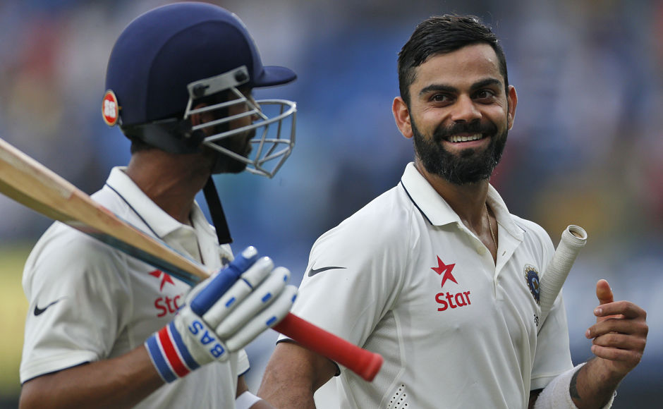 Indian cricket captain Virat Kohli, right, walks with teammate Ajinkya Rahane at the end of the first day of their third cricket test match against New Zealand in Indore, India, Saturday, Oct. 8, 2016. (AP Photo/Rafiq Maqbool)