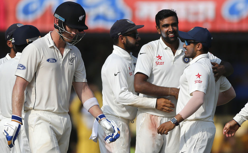 Indian bowler Ravichandran Ashwin, second from right, celebrates the wicket of New Zealand's batsman James Neesham, left, with his team players during the third day of the third test cricket match between India and New Zealand in Indore, India, Monday, Oct. 10, 2016. (AP Photo/Rafiq Maqbool)
