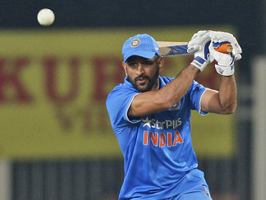 India's Mahendra Singh Dhoni plays a shot during the fourth one-day international match against New Zealand. AP
