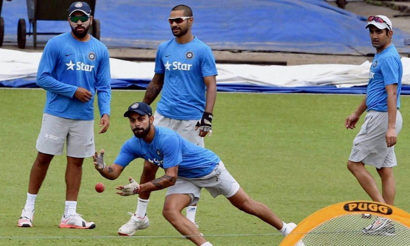 Virat Kohli and teammates Rohit Sharma, Shikhar Dhawan and Gautam Gambhir during a training session. PTI