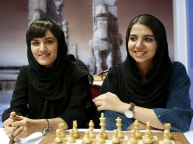 Young grandmasters Mitra Hejazipour (L) and Sara Khademalsharieh are looking forward to the world chess championships in Iran. AFP