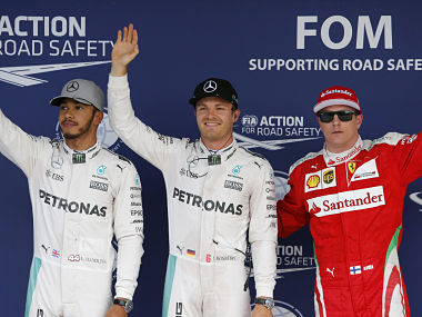 Nico Rosberg,waves with teammate Lewis Hamilton Britain and Kimi Raikkonen of Finland after taking pole for the Japanese Formula One Grand Prix. AP