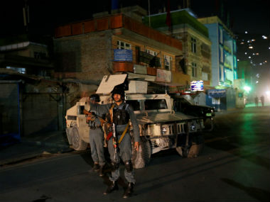 Afghan policemen stand guard near the site of an attack in Kabul. Reuters