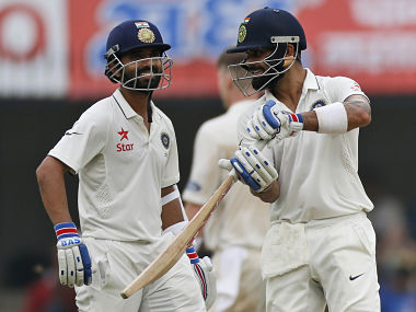 Virat Kohli and Ajinkya Rahane share a light moment during day one of the third Test. AP