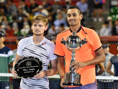 Nick Kyrgios with his Japan Open trophy. AFP