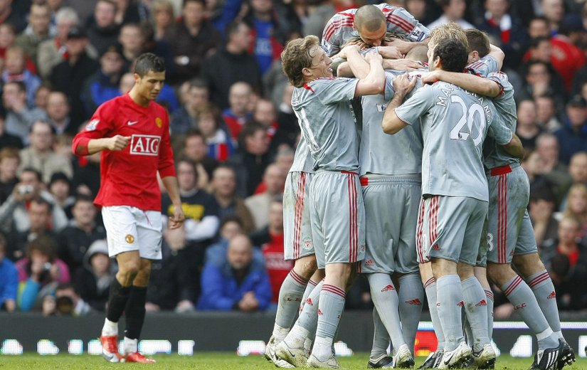 Liverpool players celebrate after Fabio Aurelio scores against Manchester United. Reuters