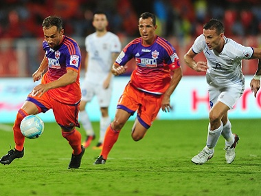 Jesus Rodriguez Tato of FC Pune City tackles the ball during match 3 of the Indian Super League (ISL) season 3 between FC Pune City and Mumbai City FC held at the Balewadi Stadium in Pune, India on the 3rd October 2016. Photo by Faheem Hussain / ISL/ SPORTZPICS