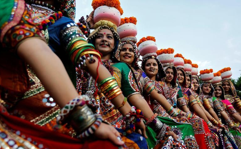 Women dressed in traditional attire pose after taking part in rehearsals for Garba, a folk dance, ahead of Navratri, a festival when devotees worship the Hindu goddess Durga, in Ahmedabad, India, September 25, 2016. REUTERS
