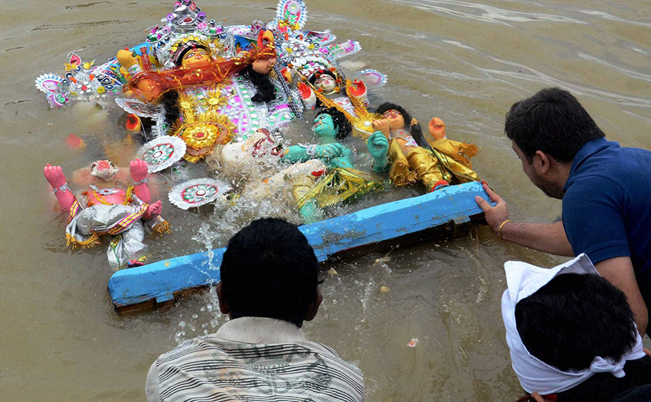 Teary-eyed devotees bade an emotional farewell, as idols of goddess Durga and her children were immersed in ponds, lakes and rivers of West Bengal on Vijaya Dashami on Tuesday, bringing to an end to five days of revelry and celebration associated with the biggest festival of eastern India. (Photo: PTI)