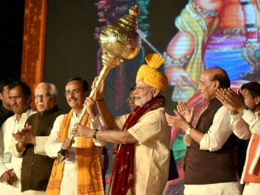 PM Narendra Modi being presented a mace as he is welcomed during Dussehra celebrations at Aishbagh Ram Leela in Lucknow. PTI