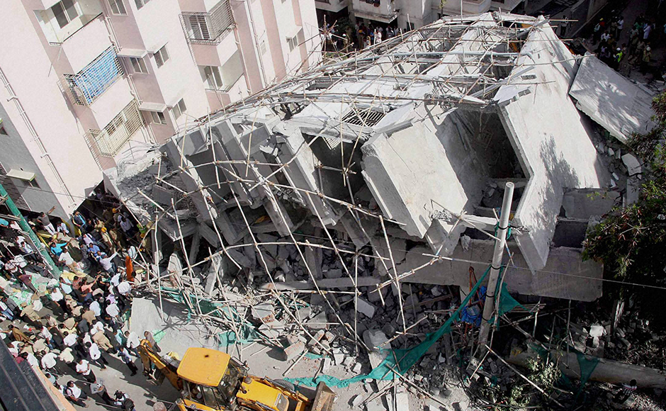 A view of a collapsed under-construction building in Bengaluru on Wednesday. PTI Photo by Shailendra Bhojak(PTI10_5_2016_000192B)