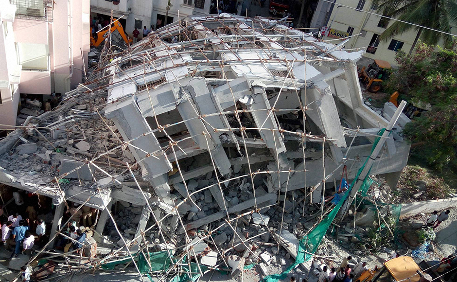 A view of a collapsed under-construction building in Bangalore on Wednesday. PTI Photo by Shailendra Bhojak(PTI10_5_2016_000196B)