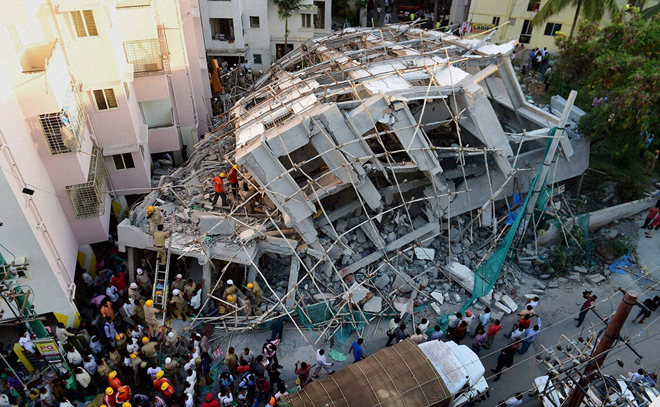 NDRF personnel carry out the rescue work after an under construction building collapsed at Belandur in Bengaluru on Wednesday. PTI Photo by Shailendra Bhojak (PTI10_5_2016_000201B)