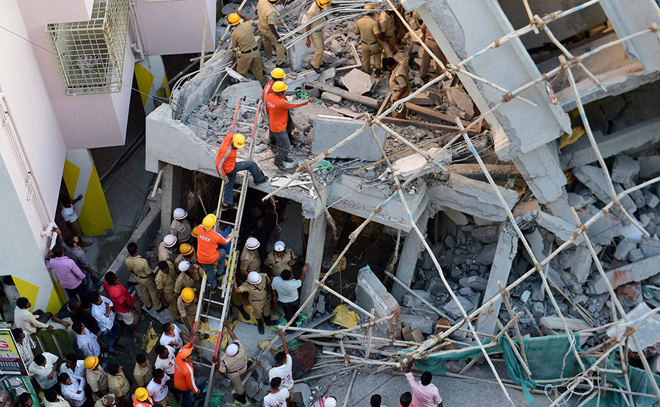 NDRF personnel carry out rescue operation at an under-construction building which collapsed in Bengaluru on Wednesday. PTI Photo by Shailendra Bhojak(PTI10_5_2016_000202B)