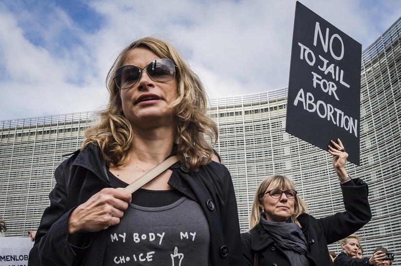 Polish women protest against a legislative proposal for a total ban on abortion in Poland, during a demonstration near EU headquarters in Brussels, Monday, Oct. 3, 2016. Many women in Poland took to the streets on Monday, boycotting their jobs and classes as part of a nationwide strike protesting a legislative proposal for a total ban on abortion. (AP Photo/Geert Vanden Wijngaert)