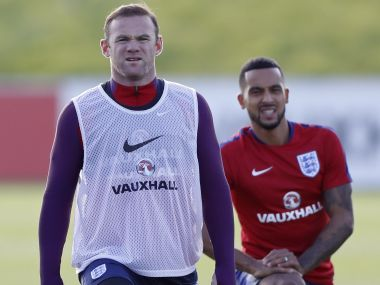 England's Wayne Rooney and Theo Walcott during training. Reuters