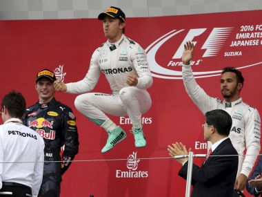 Mercedes driver Nico Rosberg celebrates on the podium after winning the Japanese GP. AP