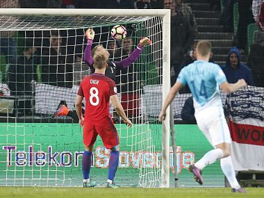England goalkeeper Joe Hart makes a save during the World Cup Group F qualifying against Slovenia. AP