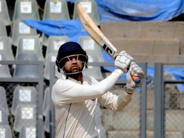 Swapnil Gugale of Maharashtra plays a shot against Delhi during their Ranji Trophy match. PTI
