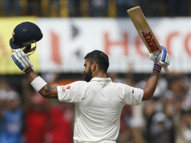 Virat Kohli celebrates his milestone. AP