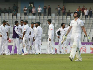 Bangladesh players celebrate the wicket of Joe Root in the second Test at Dhaka. Reuters