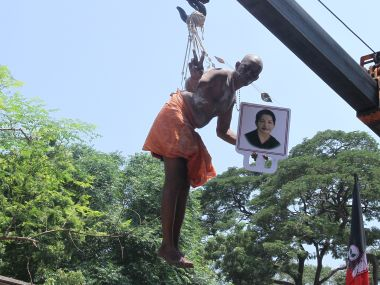 A Jayalalithaa loyalist offers prayers for his leader's recovery, suspended from a crane at the Senniamman Temple in Chennai. Photo courtesy: Vanne Srinivasulu