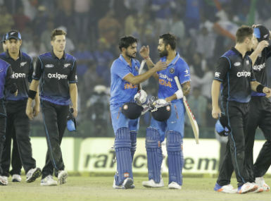 Virat Kohli and Manish Pandey celebrate India's victory over New Zealand in the third ODI in Mohali. AP