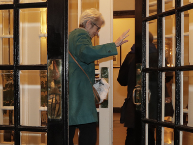 One of the Trump accusers enters her apartment building/ AP