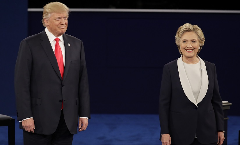 Republican presidential nominee Donald Trump stands next to Democratic presidential nominee Hillary Clinton during the second presidential debate at Washington University in St Louis. AP