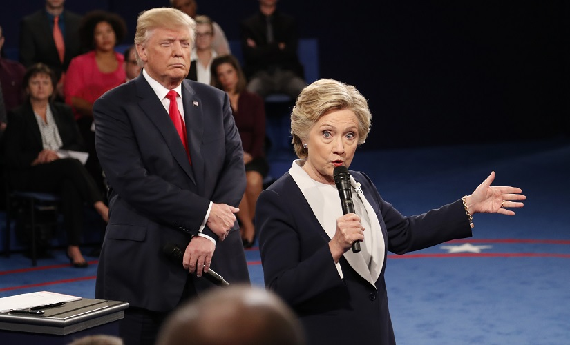 Democratic presidential nominee Hillary Clinton speaks as Republican presidential nominee Donald Trump listens during the second presidential debate. AP
