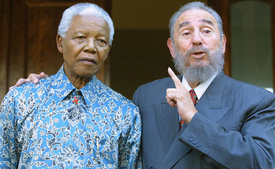 Cuban president Fidel Castro (R) expresses his joy in meeting former South African president Nelson Mandela at Mandela's office in Johannesburg 02 September 2001 . Castro who took part in the UN World Racism conference in Durban used the opportunity to visit Mandela, whose health is affected by cancer. (Photo: AFP)
