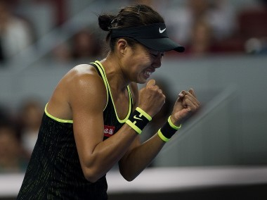 Zhang Shuai of China celebrates her victory. AFP