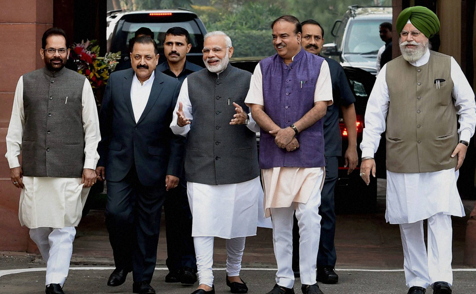 Prime Minister Narendra Modi, flanked by Parliamentary Affairs Minister Ananth Kumar and MoSes Mukhtar Abbas Naqvi, Jitendra Singh and SS Ahluwalia, arrives to address the media on the opening day of the winter session of Parliament in New Delhi on Wednesday. PTI Photo by Shahbaz Khan (STORY DEL9) (PTI11_16_2016_000026B)