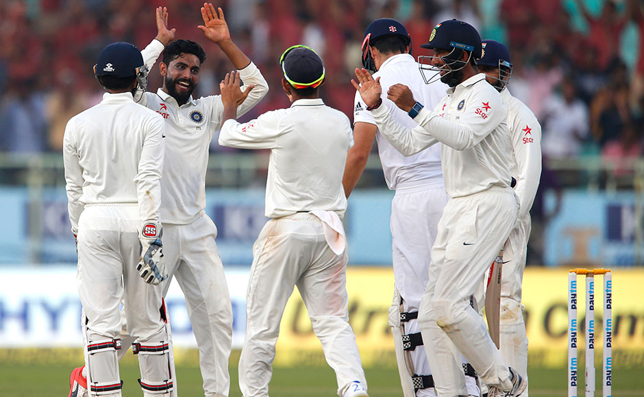 India's Ravindra Jadeja, second left, celebrates the dismissal of England's captain Alastair Cook on the fourth day of their second cricket test match in Visakhapatnam, India, Sunday, Nov. 20, 2016. (AP Photo/Aijaz Rahi)