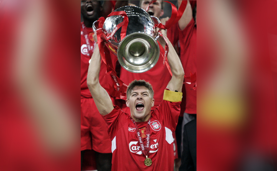 """In this Wednesday May 25, 2005 file photo, Liverpool captain Steven Gerrard holds the trophy after Liverpool's victory in the Champions League Final between AC Milan and Liverpool at the Ataturk Olympic Stadium in Istanbul, Turkey. Gerrard, the former Liverpool and England captain, announced his retirement from professional soccer on Thursday, Nov. 24, 2016 and said he is considering a """"number of options"""" about his next career move. (AP Photo/Dusan Vranic, File)"""