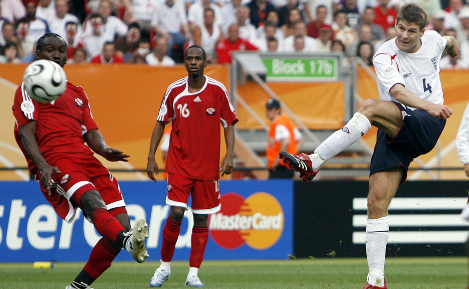 """In this Thursday, June 15, 2006 file photo, England's Steven Gerrard, right, shoots to score his side's second goal against Trinidad and Tobago during their World Cup Group B soccer match in Nuremberg, Germany. Gerrard, the former Liverpool and England captain, announced his retirement from professional soccer on Thursday, Nov. 24, 2016 and said he is considering a """"number of options"""" about his next career move. (AP Photo/Kevork Djansezian, File)"""