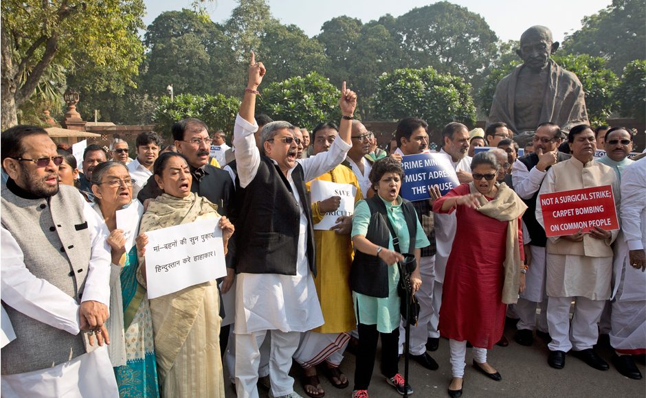 Opposition MPs including those of Congress, SP, BSP, TMC, DMK, CPI, CPI(M) among others were outside Parliament near Gandhi Statue protesting the demonetisation. (Photo: AP)