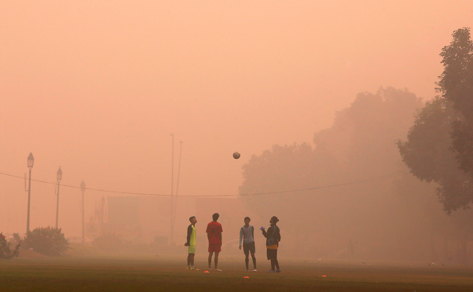 Boys play football in a public park on a smoggy morning in New Delhi, India, November 2, 2016. REUTERS/Adnan Abidi TPX IMAGES OF THE DAY