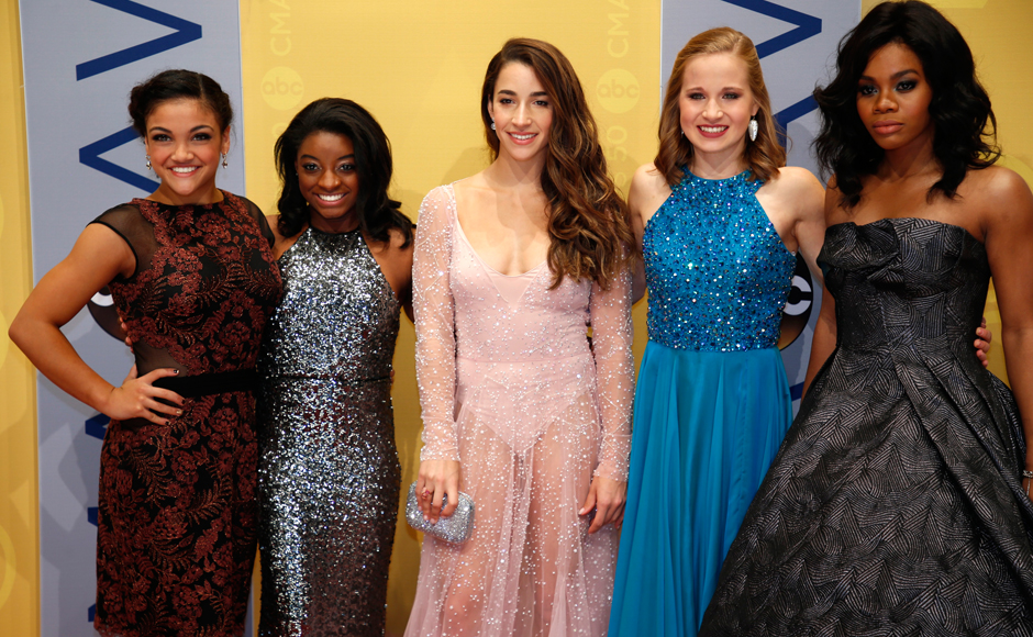 The Country Music Association Awards celebrates its 50th awards ceremony on Wednesday.  Olympic gymnasts (L-R) Laurie Hernandez, Simone Biles, Aly Raisman, Madison Kocian and Gabby Douglas at the event. (Photo: Reuters)