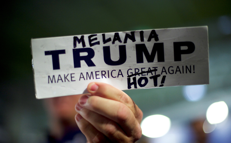 A Donald Trump supporter holds a modified campaign bumper sticker in favor of Melania Trump, wife to the Republican Presidential nominee Donald Trump, who spoke during an event at Main Line Sports in Berwyn, Pennsylvania November 3, 2016. REUTERS/Mark Makela TPX IMAGES OF THE DAY