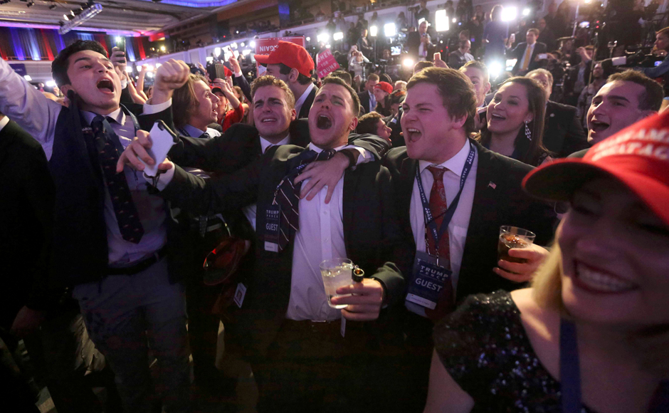 Supporters of U.S. Republican presidential nominee Donald Trump react at his election night rally in Manhattan, New York, U.S., November 8, 2016. REUTERS/Carlo Allegri TPX IMAGES OF THE DAY