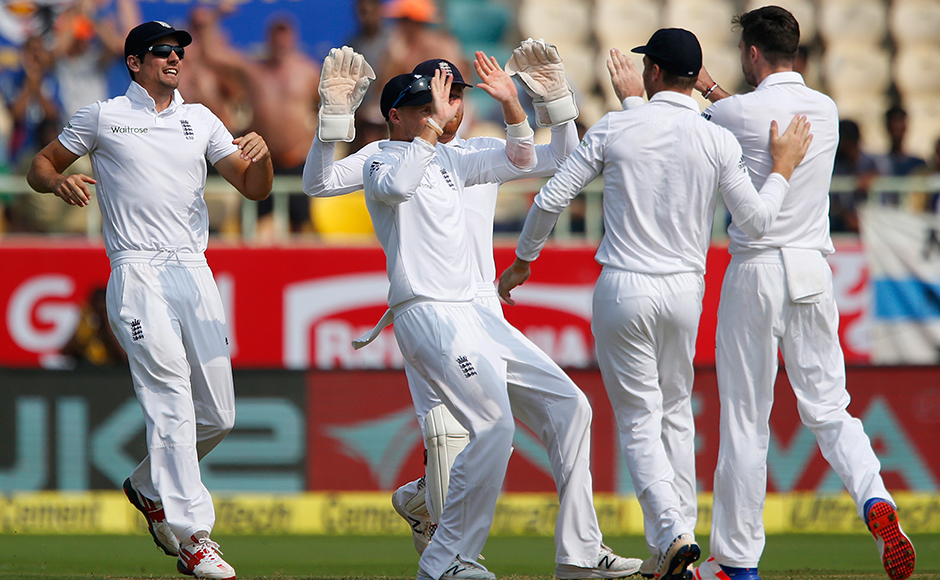 England's captain Alastair Cook, left, runs to celebrate with teammates the dismissal of India's Murali Vijay on the first day of their second cricket test match between India and England in Visakhapatnam, India, Thursday, Nov. 17, 2016. (AP Photo/Aijaz Rahi)