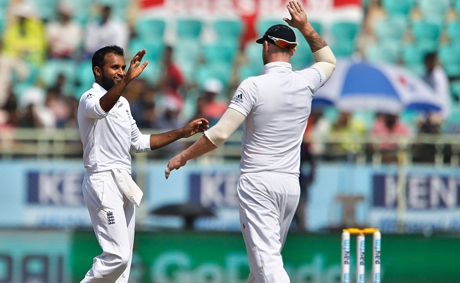 England's Adil Rashid, left, celebrates with teammate Ben Stokes the dismissal of India's Umesh Yadav on the fourth day of their second cricket test match in Visakhapatnam, India, Sunday, Nov. 20, 2016. (AP Photo/Aijaz Rahi)