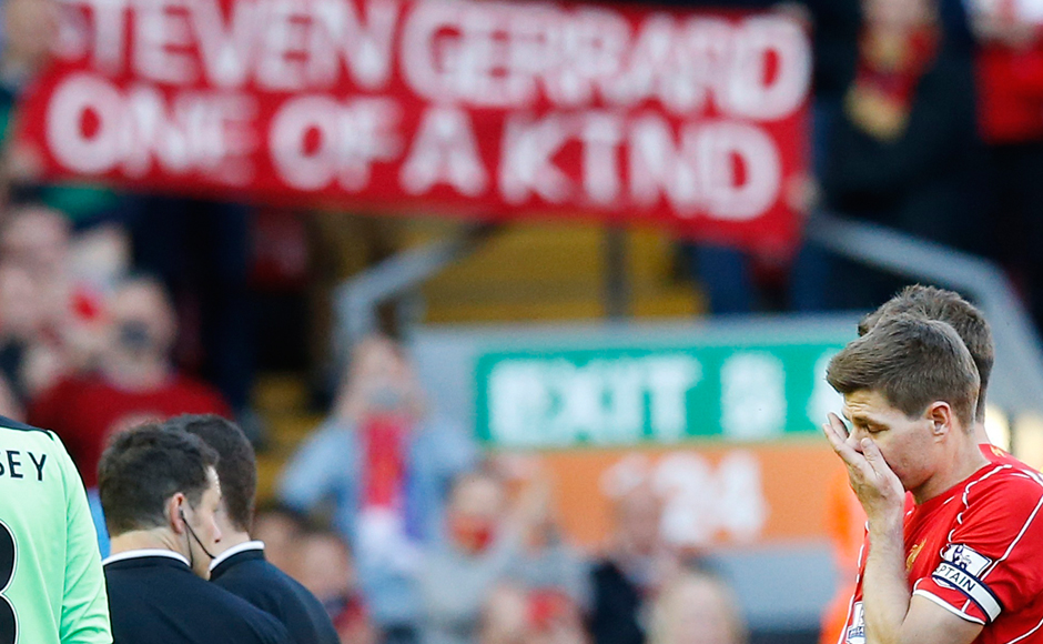 """In this Saturday, May 16, 2015 file photo, Liverpool's Steven Gerrard leaves the field after his last appearance for Liverpool against Crystal Palace. Gerrard, the former Liverpool and England captain, announced his retirement from professional soccer on Thursday, Nov. 24, 2016 and said he is considering a """"number of options"""" about his next career move. (AP Photo/Jon Super, File)"""