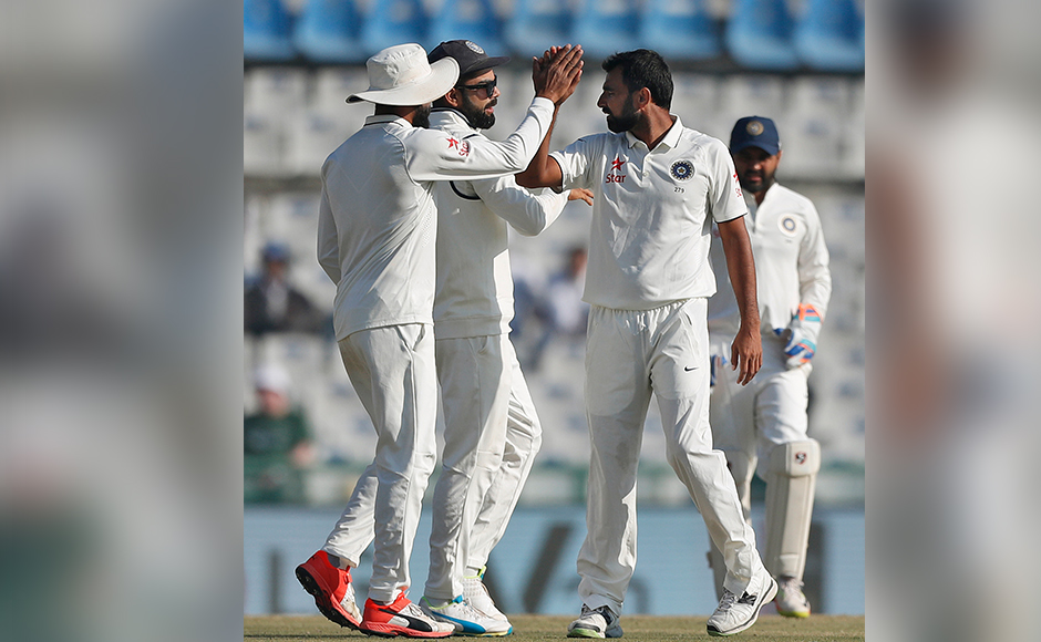 Indian cricketers celebrate the dismissal of England's Gareth Batty on the second day of their third cricket test match in Mohali, India, Sunday, Nov. 27, 2016. (AP Photo/Altaf Qadri)
