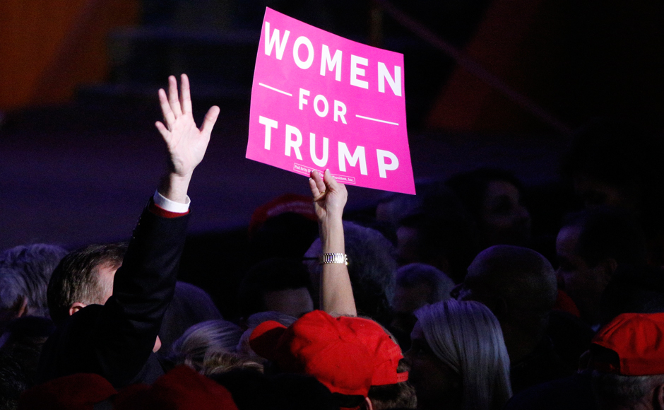 "A supporter holds up a ""Women for Trump"" sign at Republican U.S. presidential nominee Donald Trump's election night rally in Manhattan, New York, U.S., November 8, 2016. REUTERS/Brendan McDermid"