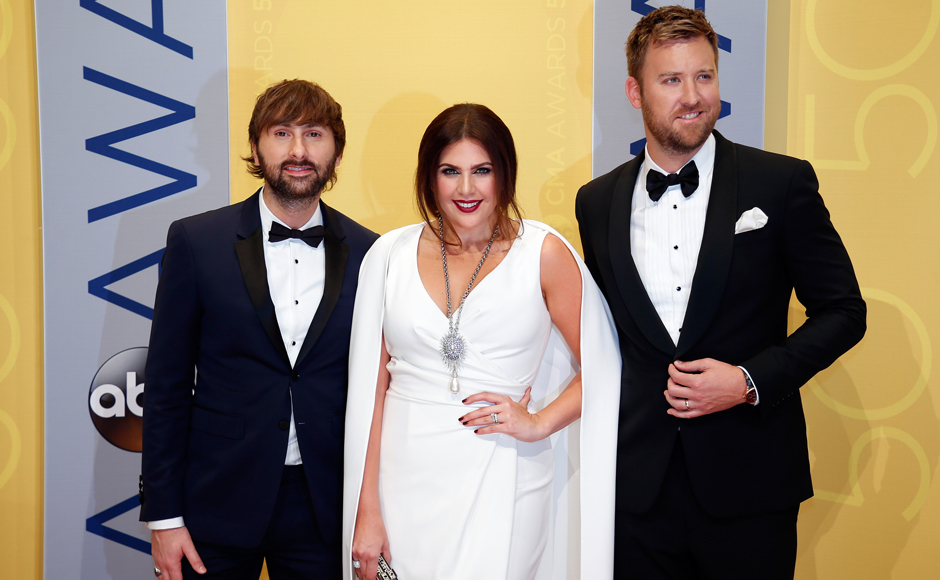 Musical group Lady Antebellum pose for pictures together at the Awards night held at the Bridgestone Arena on Wednesday in Nashville, Tenn. (Photos: Reuters)