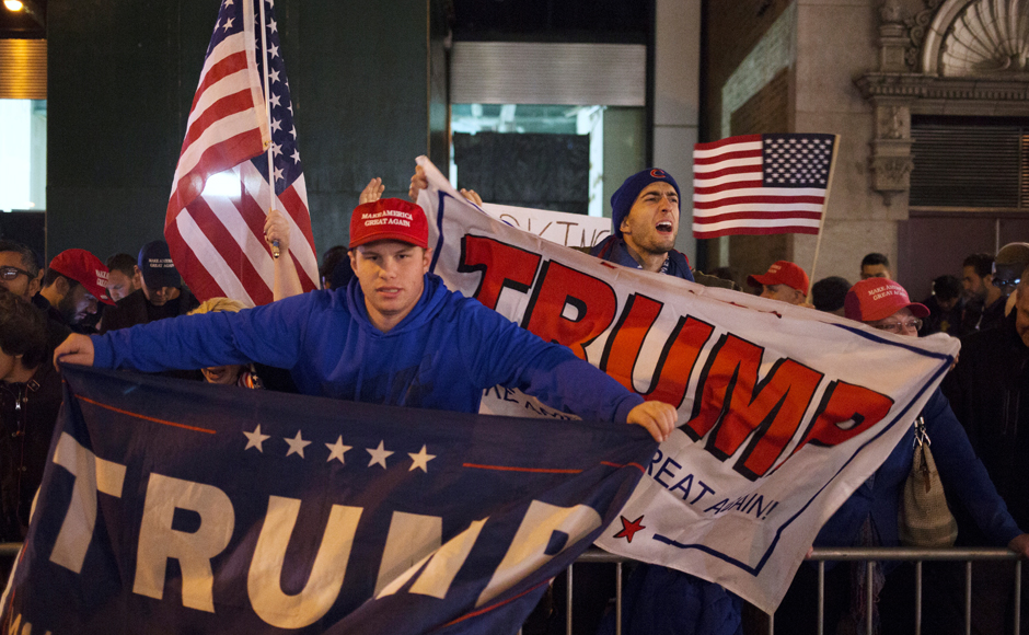 U.S. Republican presidential nominee Donald Trump supporters rally near the intersection of West 54th Street and Fifth Avenue in New York, U.S. November 8, 2016. REUTERS/Alex Wroblewski