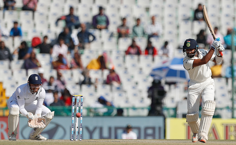 India's Cheteshwar Pujara plays a shot on the second day of their third cricket test match against England in Mohali, India, Sunday, Nov. 27, 2016. (AP Photo/Altaf Qadri)