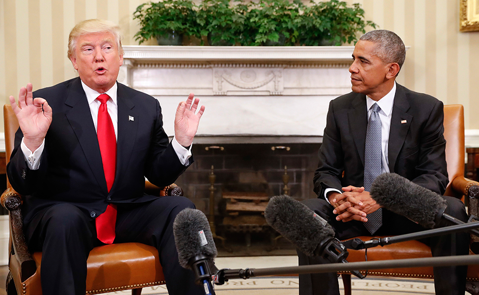 President Barack Obama listens as President-elect Donald Trump speaks during their meeting in the Oval Office of the White House in Washington, Thursday, Nov. 10, 2016. (AP Photo/Pablo Martinez Monsivais)